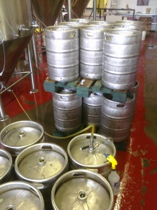 Keg being filled (Double skid of full kegs in background.)