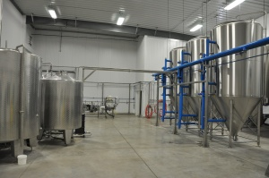 Brewhouse, fermenters and bottling line. Note the complete lack of clutter. Yes, beer is brewed here.