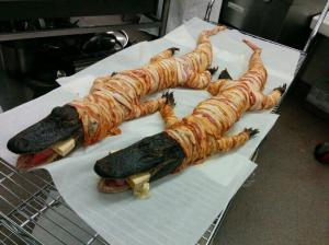 Bacon-wrapped alligators from a Louisiana bayou head out to the grill for an afternoon of slow-cooking.